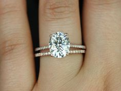 Kindof loving this ginormous oval cut solitaire style right now... I have no idea why. But I love how delicate the band is, screw chunky bands! Blake 10x8mm 14kt Rose Gold Oval FB Moissanite and Diamonds Cathedral Wedding Set (Other metals and stone options available)
