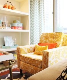 i love this bright little nook: white shelves, yellow floral chair, chevron(!) and blue striped curtains