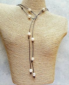 Check out this item in my Etsy shop https://www.etsy.com/listing/221855600/pearl-and-leather-necklace-leather-pearl