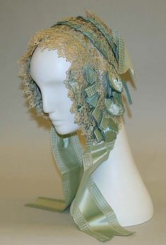 Another beautiful lace and ribbon cap, probably from the 1840s.