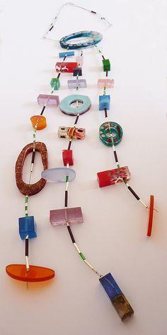 collar caramelos. varias resinas, acrílico, mostacillas de plata y vidrio, cable de acero by vania ruiz, via Flickr