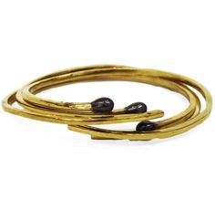 This brass bangle set is perfect for stacking! www.mooreaseal.com