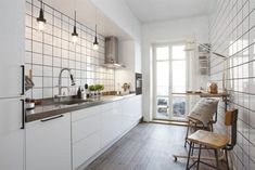 white tiles + rustic wood elements (floor and chairs) + pendants +stainless + those windows = galley kitchen <3