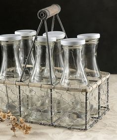 Loving this Glass Bottle & Chicken Wire Crate Set on #zulily! #zulilyfinds. You just add a fancy straw and your set for a picnic in the country.