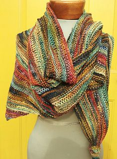 This beginner shawl pattern is designed to blend together differing colors of hand painted, short repeat yarns that ordinarily would not blend together. The stitch pattern adds texture while the garter stitch makes the project sail along.