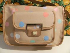 LIZ CLAIBORNE    WOMENS CANVAS SHOULDER HANDBAG    TAN W/ MULITCOLORED POLKA DOTS    BRAND NEW WITH TAGS    ZIPPERED MAIN COMPARTMENT    FRONT COMPARTMENT    WITH SNAP CLOSURE    ZIPPERED POCKET INSIDE WITH    2 ADDITIONAL POCKETS INSIDE    12 IN LENGTH    8 IN HEIGHT    8 IN DEEP    10 IN STRAP DROP    HEAVY CANVAS MATERIAL    GOLD HARDWARE    AWESOME HANDBAG    SUPER CUTE    WONDERFUL ADDITION TO    YOUR WARDROBE    SELLS FOR 70.00