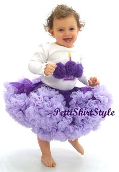This is my daughter Isabella. Her outfit is from Pettiskirt Style. Visit pettiskirtstyle.com for some really cute clothes!