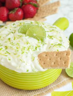 Bowl of no-bake key lime pie dip with a graham cracker dipped in