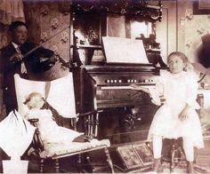 https://flic.kr/p/8tUKx9 | Brother and sister with reed organ | Brother with violin, sister seated on organ stool.