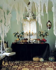 Creepy curtains made from cheese clothe.  It makes me want to try it and add glitter.