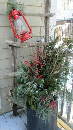 Love these Christmas Outdoor decorating ideas! Especially love that red lantern for the holiday season!