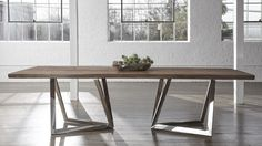 """With a solid natural cut top and geometrically inspired metal base, this table will make a statement in any Dining Room.  Dimensions - 41""""W x 96""""L x 29.5""""H"""