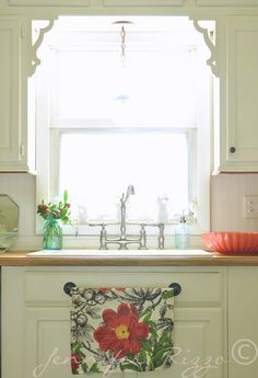 Cute Spring vignette over sink with towel