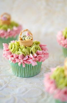 Cupcakes - like the pink flowers with the pearls in the center.  The baskets are cute, too.