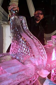 Ice luge - A drink being poured down an ice luge at an ice bar in Rochester, Minnesota - An ice luge, martini luge,[1] or shooter-block is a type of ice sculpture made from a large block of ice that has a narrow channel carved through where liquid is poured,[2] such as liquor products.[3] Some are professionally produced from sculpturing or from molds, and some are homemade. Ice luges are sometimes offered in ice bars, and have also been used for serving oysters...