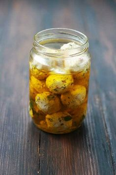 Feta and sundried tomato balls in oregano and chili flavored olive oil, authentic Greek recipes