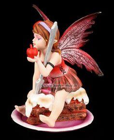 Small Fairy Figurine sitting on Cake