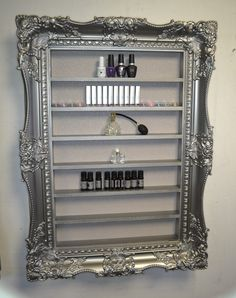 Nail polish rack display frame very wide and ornate style pewter silver  This frame is absolutely stunning..the detailing on the carved pieces is so striking and will make a massive statement piece in your salon. It has been painted in more of an antique silver giving it a stylish finish. The frame is made from solid wood and is finished with a striking soft grey sparkle wallpaper which glistens in the light - stunning   Size  97 cm x 71cms  Shelf height is 8.6  This frame is hand made to…