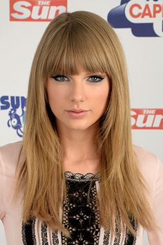 Taylor Swift - fringe / bangs - long layers that frame the face are perfect for girls a heart shaped face