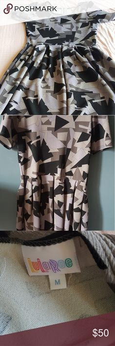 LuLaRoe Amelia dress Dress flares at wasit and also has pockets! Like new! LuLaRoe Dresses Midi