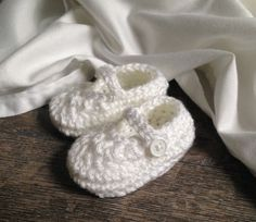 These pure white booties are the perfect accessory for your babys Christening or Baptism gown. Theyre available in boys and girls versions and are hand crafted in crisp white, super soft acrylic yarn in a smoke-free, pet-free home. These adorable little shoes are available in these sizes...  Preemie 2.5 Small Newborn 3 Average Newborn 3.25 0-3 months 3.5 3-6 months 4 6-9 months 4.5  Not recommended for walkers. Booties are slippery. For more baby booties visit my shops baby booties section…