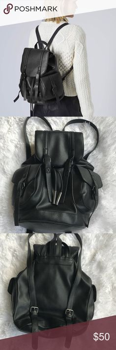 """⬆️ ⚡️TOPSHOP FLASH SALE⚡️NO 🚫OFFERS PLEASE 🎒 ⬆️ TOPSHOP """"Grainy Leather Faux Leather Large Backpack w/Pockets.""""🎒 Grainy texture faux leather backpack with side pockets, drawstring top and hanging loop. H:31CM, W:26CM. 100% Polyurethane. Specialist Clean Only. Colour: BLACK Product Code: 24J08GBLK Condition: Exterior is in EXCELLENT condition❣️❣️❣️Interior is also in EUC, with minor very minor pilling. No stains, no holes, no defects. 🚫 E-Mails 🚫Trades 🚫Lowball offers 🚫Offers during…"""