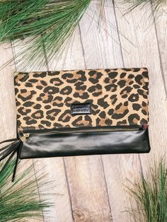 Just in time for the holidays. Shop our new fave accessories @ Miss Modern Boutique online & in store Leopard Clutch, Online Boutiques, Winter Collection, Travel Bags, Continental Wallet, Heaven, Holidays, Purses, Store