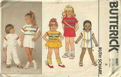 Butterick 6567; ca. 1980s; Ruth Scharf - Toddlers' or Children's Dress, Top, Jumpsuit , Shorts and Pants: Loose-fitting, pullover dress, above mid-knee, top or short, semi-fitted jumpsuit has contrast neckband, dropped shoulders and short sleeves or long sleeves with bands. Dress: slightly flared skirt. Jumpsuit: front zipper and drawstring. Shorts or pants have elastic waist. Pants: lower bands. All have purchase trim.