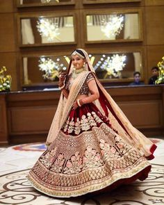 Maroon Velvet Bridal Lehenga Designs Latest - Get this maroon color velvet lehnga Indian Bridal Outfits, Indian Bridal Fashion, Indian Bridal Wear, Indian Designer Outfits, Indian Dresses, Indian Designers, Eid Dresses, Bridal Dresses, Sabyasachi Wedding Lehenga