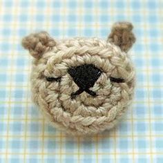 Make a miniature, crocheted bear head to wear as a brooch with this free amigurumi crochet pattern. The amigurumi emoticon bear pin is adorable for a child or even an adult, and it makes a great gift as well as a major fashion statement!