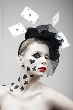 This makeup is different yet very straightforward. Usually when you see makeup, you see it on their faces. In this style of makeup, most of the makeup is going down her neck. I like how it's different and shows spades, hearts, and clubs.