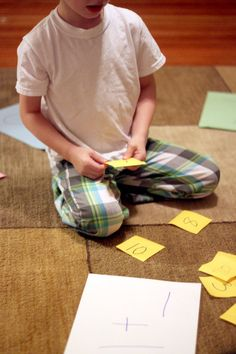 A math activity for Kindergartners - solving simple math problems like 1+3=4 - PLUS getting the kids moving.