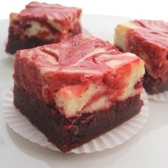 "Red Velvet Cheesecake Swirl Brownies | ""Moist, lightly chocolately red velvet brownies have a delectable swirl of cream cheese filling inside."""