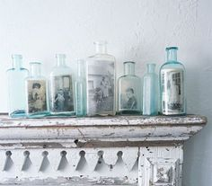 old photos in old bottles, would love to do this and place photos of the people whom have passed away that we know in spirit will be at our wedding