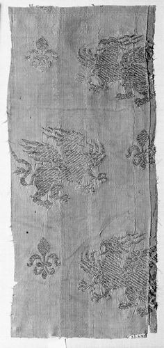 Textile fragment  Tartar, Central Asian 13th–14th century  Object Place: Italy or France  DIMENSIONS 16 x 34.5 cm (6 5/16 x 13 9/16 in.)  MEDIUM OR TECHNIQUE Silk plain weave with supplementary metallic patterning wefts