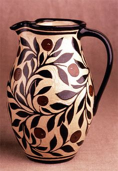 Katherine Hackl's Sgraffitto Pottery line is a selection of black and tan functional ware decorated with a continually changing array of elegant botanical motifs, geometric patterns and stories.