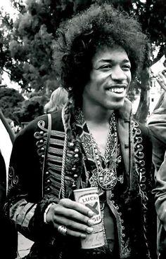 A smiling Jimi Hendrix in a fabulous jacket