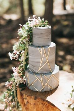 Magical Maine Woodland Wedding Inspiration | blue and gold three tier wedding cake with dreamy wildflower detail | @danellesbridal | danellesboutique.com
