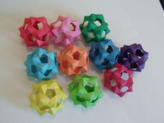 Seems to be called a PHiZZ ball, modular origami, thing, I just made one, pretty impressive looking, although, I did cheat and use a little glue here and there...