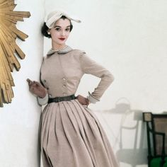 Nan Rees, January 1952    Wearing a beige Sirrey Classics dress with a gray linen collar and cuffs and a John Frederics Charmer hat.