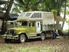 Toyota Land Cruiser FJ45 pick-up camper.  Just awesome.