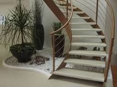 If you have an empty space under the stairs in your home, then maybe you can use this space for an indoor garden. And not any type of garden, but a small pebble garden that will Small Garden Under Stairs, Indoor Garden, Home And Garden, Zen Interiors, Pebble Garden, Modern Stairs, Interior Garden, House Stairs, Beautiful Gardens