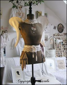I love this dress form and the shadowbox in the background has been in another photo and it is fabulous