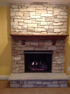 Masonry Fireplace w/ VF Log. Stone and Mantle by homeowner