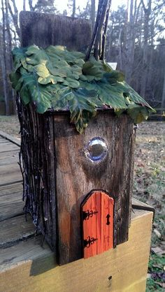 Fairy House with leaves as a roof and a marble as a window