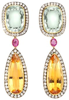 A pair of aquamarine, topaz and diamond earrings, each aquamarine and diamond cushion shaped cluster suspending a precious topaz and diamond tear shaped drop set with an oval ruby intersection mounted in silver and gold.