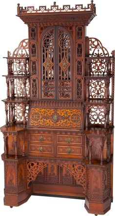 An Anglo-Indian Carved Mahogany Secretary Bookcase, mid-19th century.