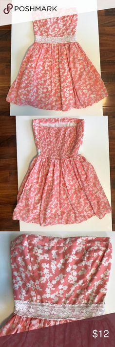 Abercrombie kids Peach Strapless Floral Dress This dress is strapless. The flowers are white. There is a white crochet / lace band at the waist. It is a light orange/ peach / coral color. Abercombie Kids Dresses