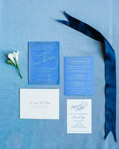We love these elegant blue and gold wedding invitations featured in our 2015 Wedding Guide: http://weddingguide.thebolditalic.com/ CAROL SCHEFFLER DESIGN: Carol is a seasoned graphic designer who launched into weddings/events after her engagement. She is passionate about telling a couple's story through the style of their wedding stationery suite.