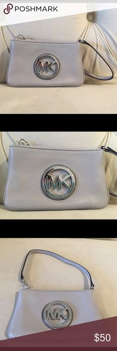 Michael Kors Wristlet Like new Michael Kors wristlet/mini bagwith a small shoulder strap. Color: light gray. Perfect condition. Inside pocket and credit card slots. No scratches, rips or stains. Michael Kors Bags Mini Bags